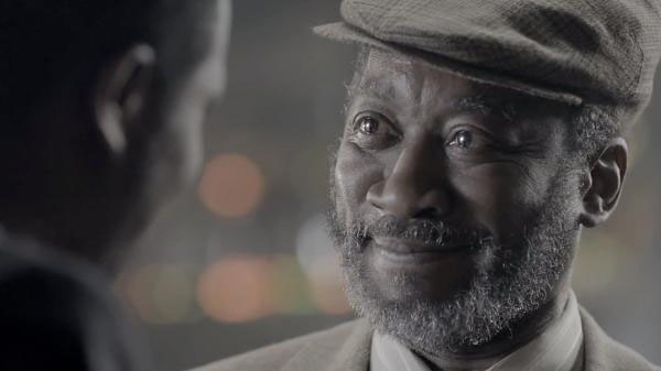 An old man smiling in Bell's 'The Reader' TV advert
