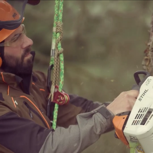 A still from our case study video for Stihl, showing an arborist using a saw.