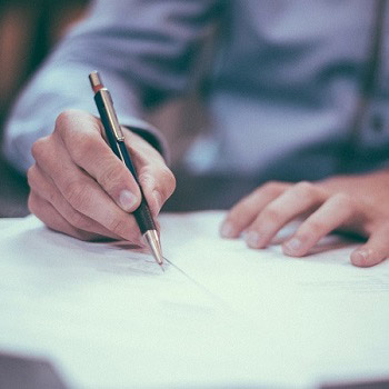 A man writing a corporate video script.