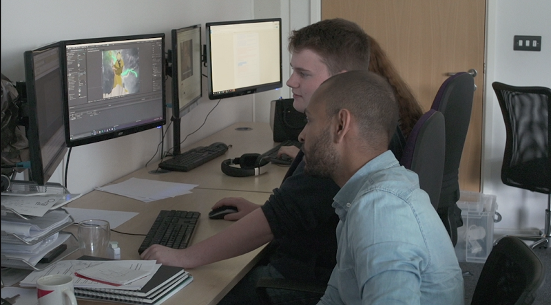 Morgan working on his GIF with our motion graphics designer Troy.