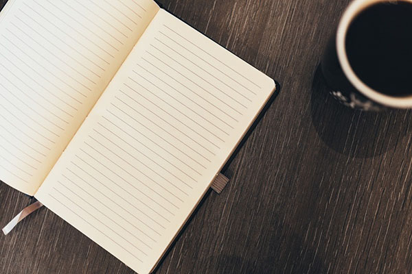 A blank notebook page, ready to jot down a video production brief.