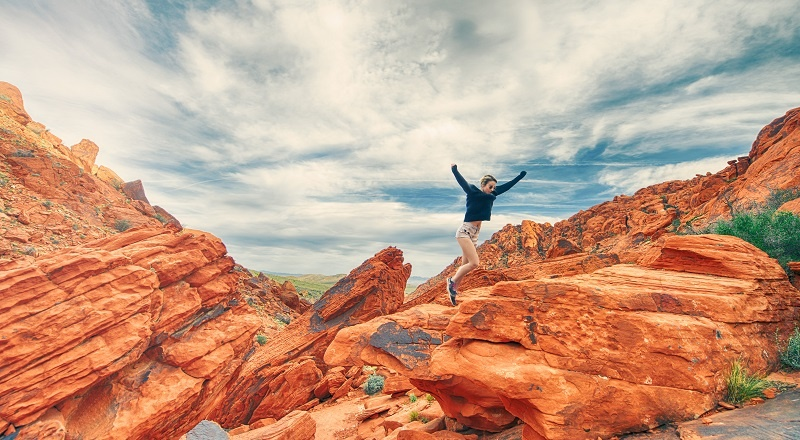 A woman jumping happily in the air (because video strategy is happening).